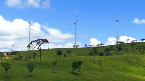 Wind turbines on green hills - wind farm Footage