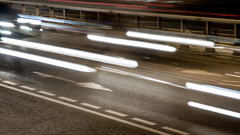 The light of car headlights on the road, night timelapse Footage