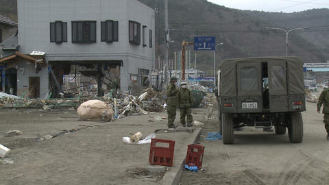 Military Soldiers In Tsunami Destruction Zone Japan Footage