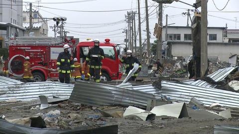 Japan Tsunami Aftermath - Fire Crew Walks Through Port stock footage