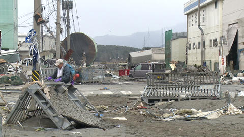 Japan Tsunami Aftermath - Man Walks Through Destroyed Port Footage