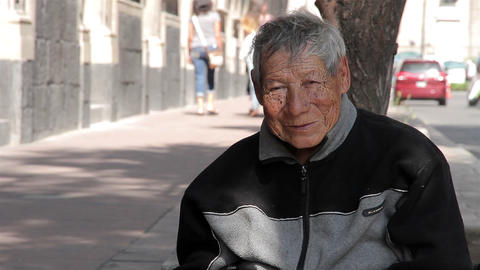 Mexico City, Mexico-August 2014: MEDIUM SHOT. Old Man Sitting In The Sidewalk stock footage