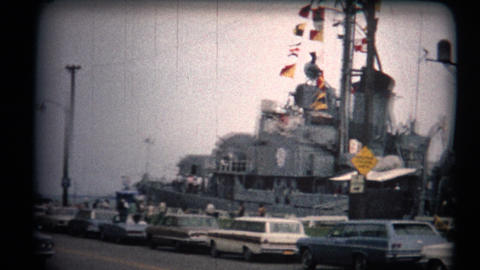 (8mm Vintage 1970s) Warship Tour Pan Old Classic Cars. A look at a USA warship p Footage