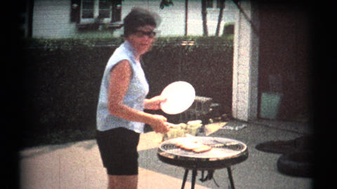 (8mm Vintage 1970s) Women BBQ Grill Gets Angry . Women hates to be filmed whole Footage