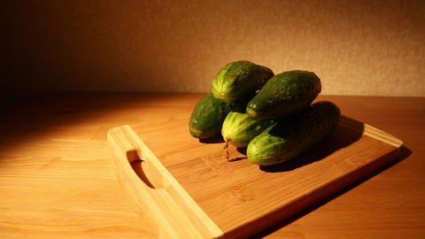 Cucumbers on a cutting board Footage