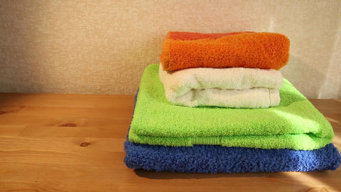 Four towels on a table Footage