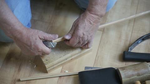 cutting narrow strip of wood Footage