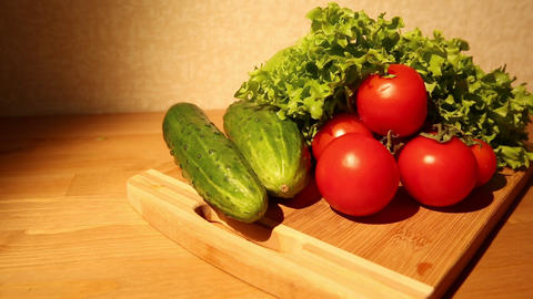 Vegetables on cutting board Footage