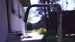 Old Dripping Faucet.Concept Of Water Wastage Footage