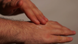 Man Applying Hand Lotion stock footage