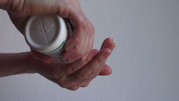 Woman Hands Taking Pill From The Bottle stock footage