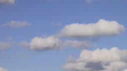 White Clouds Flying On Blue Sky, motion speed Footage