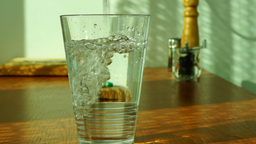 Pouring Glass Of Water Reverse Speed real time Footage
