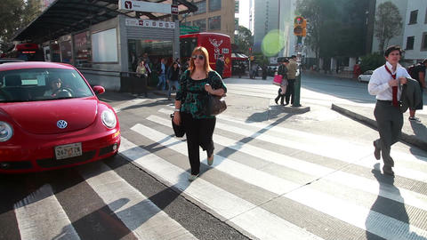 Mexico City, 2014: FULL SHOT-HANDHELD-DOLLY IN. People Croosing The Street stock footage