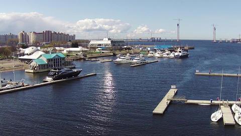 Flying Above Yachts at a Marina Footage