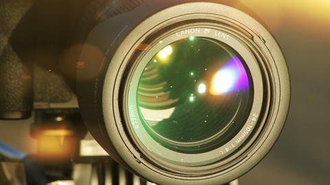 Flares on Lens. Close-up shot of professional camera. HD 1080 Footage