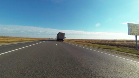 Country Road under blue sky with sun Footage