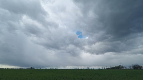 Dark Clouds Sweep Over the Green Field Footage