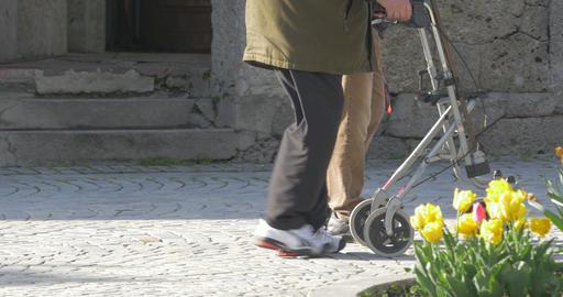 4K, elderly man is walking with a walking frame Footage