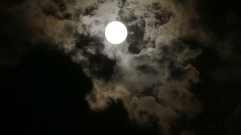 Full moon behind clouds at night Footage