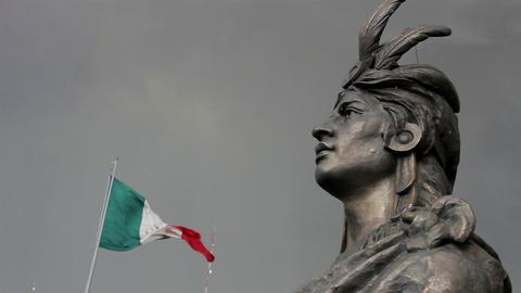 Mexico City, Mexico-August 2014: MEDIUM SHOT-PAN LEFT. Moctezuma's Statue Live Action