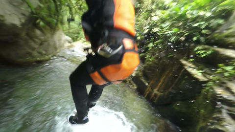 Outdoor waterfall canyoning extreme sport HD Footage