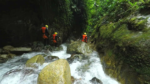 Group of tourists exploring Ecuadorian canyon in Llanganates national park Footage