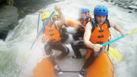 Group of happy people on white water expedition Footage