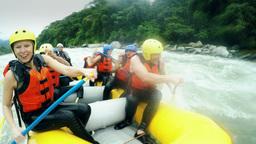 Adult Caucasian family having fun on white water rafting trip nine people group Footage