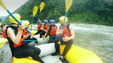 Adult Caucasian Family Having Fun On White Water Rafting Trip Nine People Group stock footage