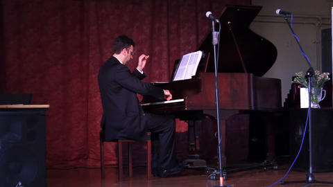Male playing the piano on the stage Live Action