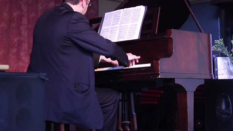 Male playing the piano with passion Live Action