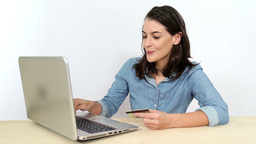 Woman with credit card order online products from shopping websites Footage