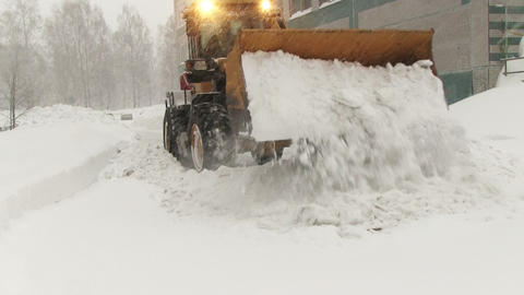 Snowplow Removes A Lot Of Snow In The City stock footage