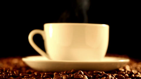 Coffee cup on beans Footage