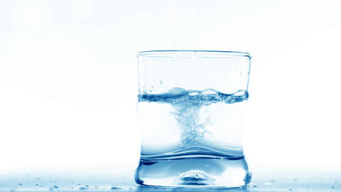 Pouring water into glass Footage