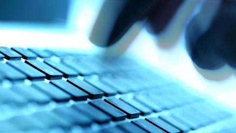 Fingers typing on keyboard Footage