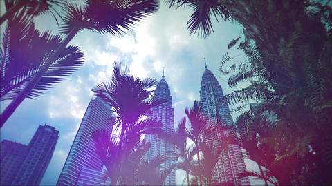 KUALA LUMPUR - February 2015: Retro look Petronas Twin Towers with palm trees, K Footage
