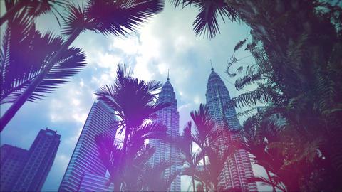 KUALA LUMPUR - February 2015: Retro look Petronas Twin Towers with palm trees, K Footage