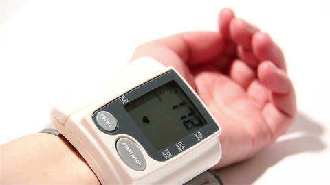 Checking Blood Pressure 13 wrist Stock Video Footage