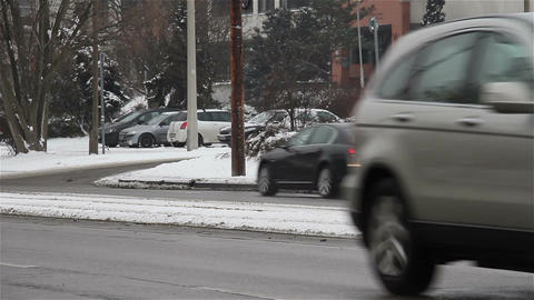 Snowy Suburb 13 traffic Stock Video Footage