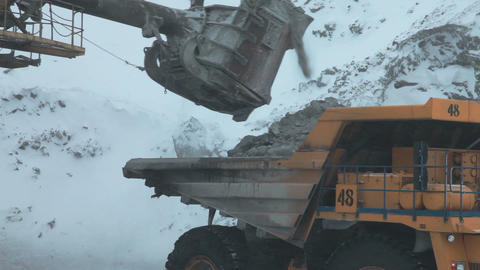 Dump truck loaded with an excavator Stock Video Footage