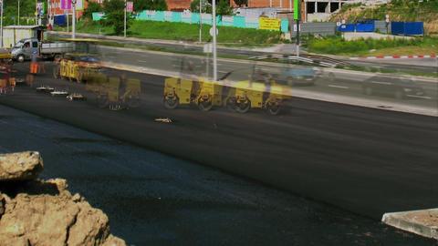 Road workers at the asphalt repairing works Stock Video Footage