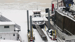Ice on River 32 shipyard dock Stock Video Footage