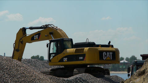 Yellow excavator loading gravel Stock Video Footage