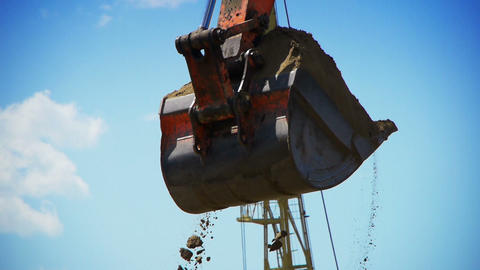 Red excavator working on a construction site Stock Video Footage