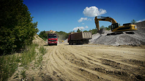 Red truck arrived to load gravel Stock Video Footage