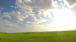 Sun and Clouds over Fields. Timelapse UHD Footage