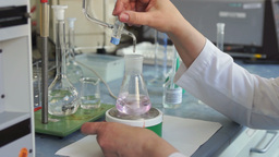 Chemical reaction and analysis in pharmaceutical laboratory Footage