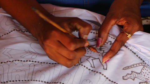 Hand of a woman drawing on the fabric - Sri Lanka Footage